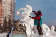 "Stock Photo of festival ""magic ice of siberia"", sculptor creates a sculpture from snow"