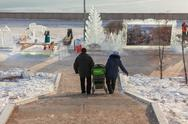 "Stock Photo of festival ""magic ice of siberia"", married couple with a children's carriage co"