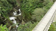 Suspended bridge over Pastaza river and Pailon del Diablo waterfall in Stock Footage