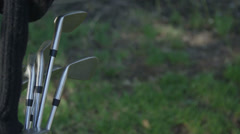 Close-up of a golfer pulling a club from his bag. - stock footage