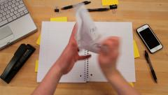 Ripping, crumpling and tossing paper from notebook, top view Stock Footage