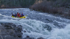 Rafters tackle white water rapids. - stock footage