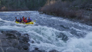 Stock Video Footage of Rafters tackle white water rapids.