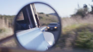 Stock Video Footage of Close-up of the rear view mirror of an old pickup truck as it drives through a