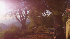 A group of friends enter a campsite. - stock footage
