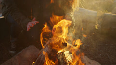 Close-up of a couple warming their hands over a campfire. Stock Footage