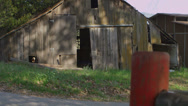 Stock Video Footage of An old pickup truck pulls up outside an old barn.