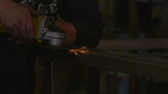 Sparks fly as a worker edges with a tool in a workshop. Stock Footage