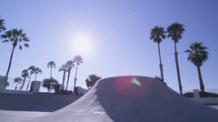 A BMX bike rider jumps at a skatepark. Stock Footage