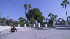 A BMX bike rider executes a high jump at a skatepark. - stock footage