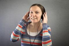 Stock Photo of portrait of a beautiful woman with headphones.