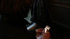 Train journey, Iphone used (hidden face) Stock Footage