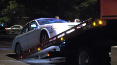 Tow truck loads the missing car WS Stock Footage