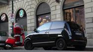Stock Video Footage of Car passes Santa on Vespa