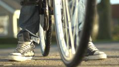 Kid with sneakers on bike bicycle Stock Footage