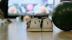 Bowling alley with shoes and ball - stock footage