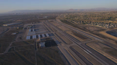 Aerial view of a small airport near Las Vegas, Nevada with suburban sprawl in Stock Footage