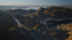 Aerial view of the Hoover Dam with Lake Mead in the background. - stock footage