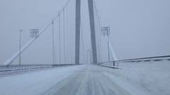 Driving over a snow-covered suspension bridge Stock Footage