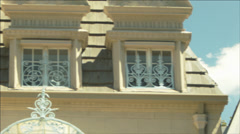 Camera Pans (R->L) Across The Upper Story Windows Of A French Provincial Chateau Stock Footage