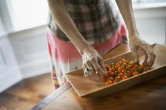 Stock Photo of organic produce. a tray of freshly picked organic tomatoes in the kitchen.