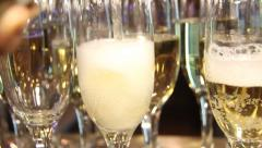 Pouring a full beaker of champagne - stock footage