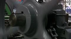 Stationary steam engine flywheel close up Stock Footage