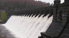 Overflow water cascading over Lake Vyrnwy dam, Powys, Wales, January 28th 2014. - stock footage