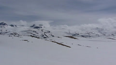 Sognefjellet mountain pass - glacial landscape  covered with snow + pan Stock Footage