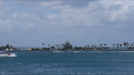 Stock Video Footage of US Coast Guard next to coastline palm tree island