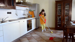 Happy housewife cleaning and dancing - stock footage
