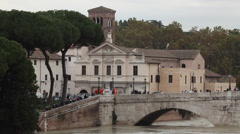Isola Tiberina, Rome, Italy, with Tiber River full of water Stock Footage