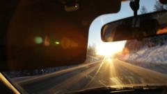 Driving against the blinding sun Stock Footage