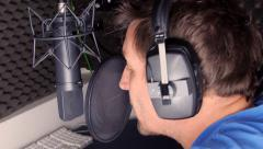 Voiceover artist recording in studio - stock footage