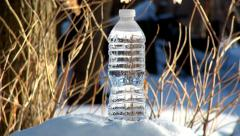 Freezing plastic bottle of water in real time Stock Footage
