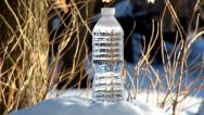 Stock Video Footage of Freezing bottle of water in real time