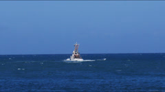 Us coast guard cutter at sea - blue ocean back view Stock Footage