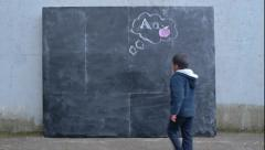 "Little Multi-Ethnic Boy Under A Chalkboard Thought Cloud Of ""Aa"" & an Apple Stock Footage"