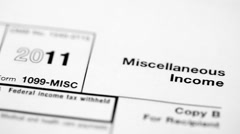 Montage of multiple macro shots of tax forms Stock Footage
