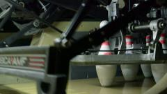 Automated pinsetter sets up bowling pins - stock footage