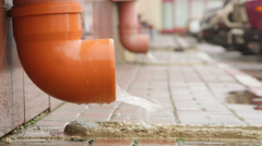 Rain water flowing from drain pipe Stock Footage