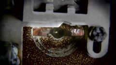 Eye looking through keyhole Stock Footage