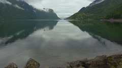 SOGNEFJORD, NORWAY: view over water fjord + tilt up cloudy sky Stock Footage