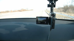 Parked car with recording DVR on windshield Stock Footage