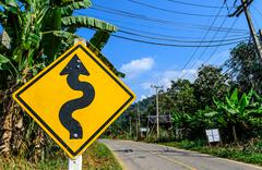 Right winding road traffic sign Stock Photos