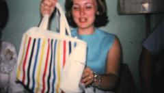 Girl Gets New Bag At Bridal Shower Party-1967 Vintage 8mm film - stock footage