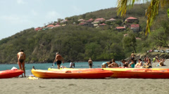 Guadeloupe Basse Terre district 053  People around boats on the beach Stock Footage