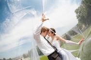 Stock Photo of kiss of two under the veil