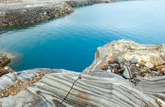Striped stone near reservoir storglomvatnet (meloy, norge) Stock Photos