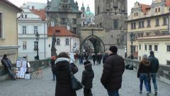 Prague Charles bridge, day time with passersby vanishing point HD - stock footage